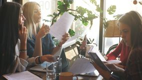 Company businessman discussing documents sitting in a cafe. Company Businesswoman sign a contract in a cafe stock video footage