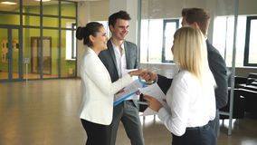 Company businessmen shaking hands. In office stock footage