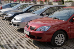 Company cars, parked. A row of similar cars parked in a parking lot royalty free stock photos