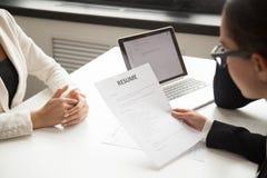 Company representatives reading applicant resume at hiring stock photography