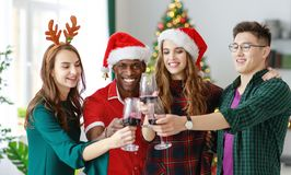 Company of cheerful and happy friends celebrating at christmas d royalty free stock images
