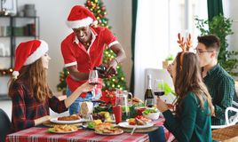 Company of cheerful and happy friends celebrating at christmas d royalty free stock photo