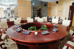 Company conference room. With round table and leather chairs Stock Photo