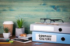 Company Culture. Binders on desk in the office. Business background.  Royalty Free Stock Photo