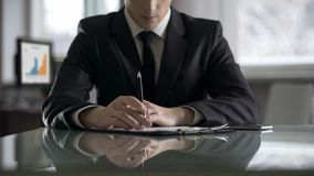 Company director thinking seriously on document, difficult business decision royalty free stock image