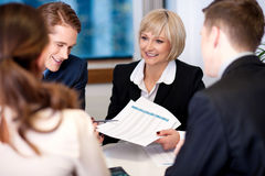 Company discussion going on in a meeting hall Royalty Free Stock Photography