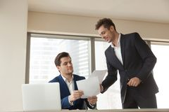 Businessman shoving project documents to investor. Company employee giving business papers to head manager for approval. Investment advisor presenting project royalty free stock images