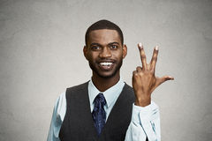 Company employee giving three times fingers gesture royalty free stock photos