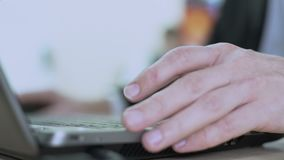 IT company employee working on computer, developing software, close-up on hands. Stock footage stock video footage