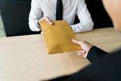 Company employees have been corrupt by bringing money to the company`s human resources department. To allow him. To be promoted to manager stock photography