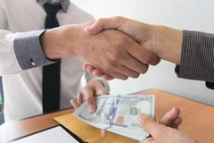 Company employees have been corrupt by bringing money to the company`s human resources department. To allow him. To be promoted to manager royalty free stock photography