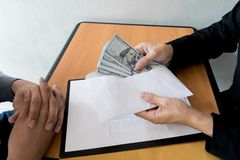 Company employees have been corrupt by bringing money to the company`s human resources department. To allow him. To be promoted to manager stock photos