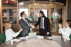 Company executive promoting successful manager handshaking while
