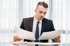Executive business analyst manager working office. Company executive, business analyst or corporate manager working in office. documents review, paperwork royalty free stock photos