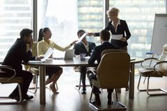 Free Company Executive Giving Papers Presenting New Business Plan To Team Stock Photography - 139893832