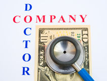 Company finances; a health check. The text company and doctor surrounding a ten Dollar bill overlaid with a stethoscope.  Company doctors are usually Royalty Free Stock Image