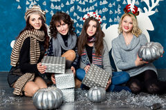 Company of four girls in blue and white Christmas decorations Stock Image