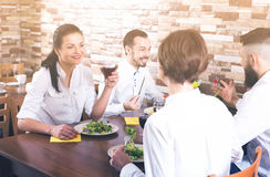 Company of four spends time at dinner Royalty Free Stock Images