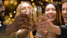 Company of friends clinking champagne glasses at new year party, having fun. Stock footage stock footage
