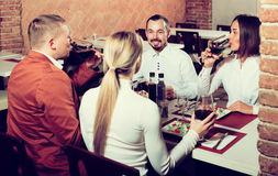 Company of friends eating delicious dinner Stock Photo