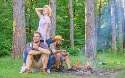 Company friends enjoy relaxing together forest. Company most important thing organizing vacation. Awesome hiking and. Great company. Friends relaxing near stock photography