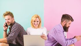 Company friends with mobile gadgets laptop. Modern technology. Men and woman networking by devices instead real. Company friends with mobile gadgets laptop royalty free stock image
