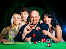 Company of friends plays dice Royalty Free Stock Images