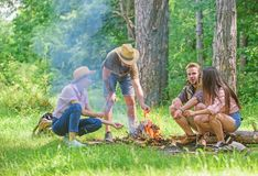 Company friends prepare roasted marshmallows snack nature background. Camping activity. Company youth camping forest. Roasting marshmallows. Roasting stock photography