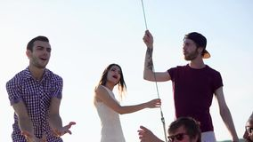 The company of friends spends time on the yacht, friends actively dance to music stock footage