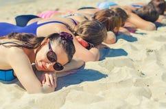 Company of girls sunbathing Stock Photo