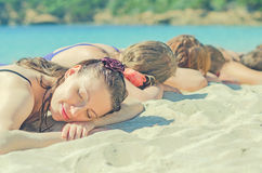 Company of girls sunbathing Stock Photos