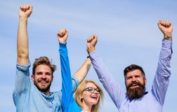 Company happy colleagues office workers enjoy freedom friday evening, sky background. Employees enjoy feeling of freedom. Men with beard in formal wear and royalty free stock image