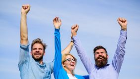 Company happy colleagues office workers enjoy freedom friday evening, sky background. Men with beard in formal wear and. Girl finished working week. Employees royalty free stock image
