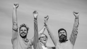 Company happy colleagues office workers enjoy freedom friday evening, sky background. Men with beard in formal wear and. Girl finished working week. Employees stock image