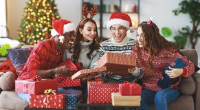 company of happy  friends celebrating Christmas and New Year stock photos