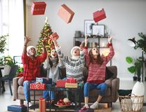 Company of happy friends celebrating Christmas and New Year royalty free stock images
