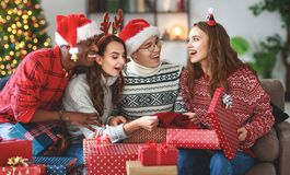 Company of happy friends celebrating Christmas and New Year royalty free stock photo