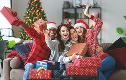 Company of happy friends celebrating Christmas and New Year royalty free stock photos
