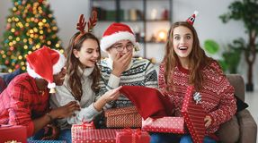 Company of happy friends celebrating Christmas and New Year stock image