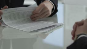 Company head looking through contract and returning, disadvantageous conditions. Stock footage stock video footage