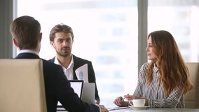 Chief rear view discussing with employees check statistics sales results. Company head sitting at desk with staff employees analyse sales stats results in graphs stock video footage