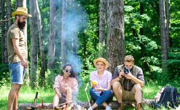 Company hikers relaxing at picnic forest background. Camping and hiking. Company friends relaxing and having snack. Picnic nature background. Spend great time royalty free stock images