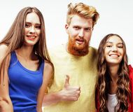 Company of hipster guys, bearded red hair boy and girls students having fun together friends, diverse fashion style Royalty Free Stock Photography