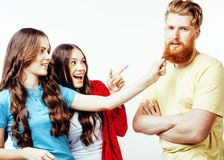 Company of hipster guys, bearded red hair boy and girls students having fun together friends, diverse fashion style Stock Image