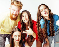 Company of hipster guys, bearded red hair boy and girls students having fun together friends, diverse fashion style Stock Photography