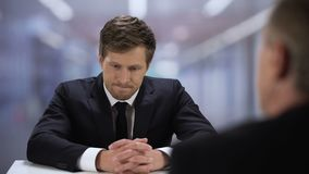 Company HR manager watching through young man resume, job interview failure