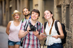 Company of impressed travelers Stock Photography