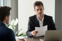 Entrepreneur studying deal conditions in office stock images