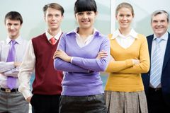 Company of leaders. Portrait of five co-workers with their young leader in front Royalty Free Stock Images
