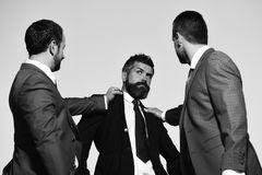 Company leaders fight for business leadership. Business conflict and argument. Concept. Businessmen with confident faces in formal suits on grey background stock images